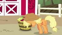 Applejack pushing a barrel of apples S7E14