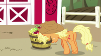 Applejack pushing a barrel of apples S7E14