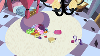 Bellhop buried under Rarity's luggage S2E09