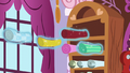 Pieces of fabric being levitated out of shelf S5E14.png
