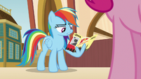 Rainbow looks at Hall of Fame brochure S9E6