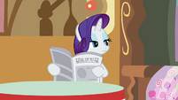 Rarity looking through the newspaper S2E23