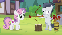 Rumble holding a bow and arrow S7E21