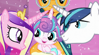 Shining Armor and Princess Cadance look at their baby S6E2