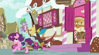 Sugar Belle runs past Spike and Discord S9E23