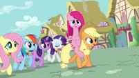 Pinkie Pie riding on Applejack's back S03E13