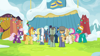 Ponies crowded around Flim and Flam's stand MLPBGE