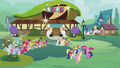 Ponies gathered outside the bowling alley S5E9.png