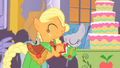 Applejack bringing apple cake into hall 2 S1E26.png