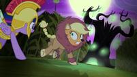 Applejack runs toward a spooky tree S5E21
