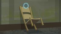 Chair blocking the window display room door S6E9