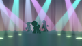 Feather and backup dancers' silhouettes on stage S7E8.png
