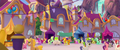 Ponies mingle in the Canterlot plaza MLPTM.png