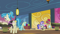 Several ponies at the bowling center S5E9