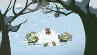 Yona and family around smashed snow fort S8E16