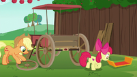 Apple Bloom drags car spoiler across the grass S6E14