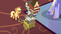 Applejack looking at tall stack of photo albums S6E21.png