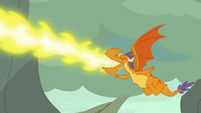 Billy blowing fire as he shouts -go!- S7E25
