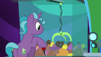 Hotel pony playing a claw machine game S8E5
