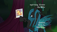Queen Chrysalis straightening Applejack's photo S8E13