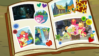 Scrapbook containing the family pictures S4E09