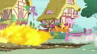 Spike and Smolder avoid the giant fireball S8E24