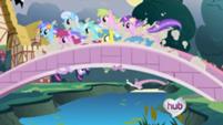 201px-Running over the bridge S1E03