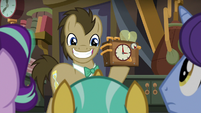 Dr. Hooves grinning and holding up a clock S9E20