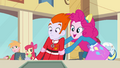 Pinkie Pie putting male student's arms down EG.png