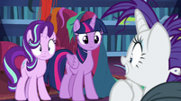 Rarity looks at Twilight and Starlight S7E19