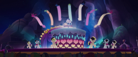 Songbird performing with backup dancers and birds MLPTM