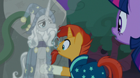 Sunburst waves his hoof through Star Swirl's image S7E25