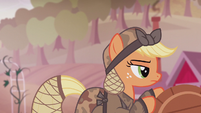 Applejack pushing a barrel S5E25