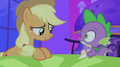 Applejack seeing Spike holding Cadance figurine S2E25.png