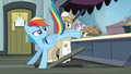 Rainbow kicking paper bags over the counter S4E22.png