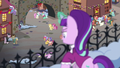 Snowfall looks below a crowd of ponies S06E08.png