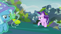 Starlight levitates Trixie out of the throne room S7E17