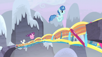 Village ponies bounce across the bridge S5E2