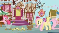 201px-Fluttershy leads the ducks past Sugarcube Corner S1E05