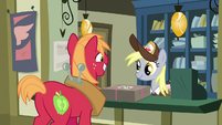 Big Mac giving Derpy a package to mail S8E10