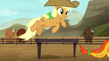 Brown rodeo mare jumping over hurdle S5E6.png