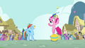 Pinkie Pie throws cupcake into Rainbow's mouth S4E12.png