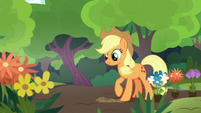 Applejack digging a small hole in the dirt S7E5