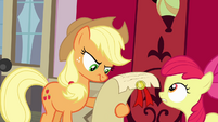 Applejack looking at scroll S4E09
