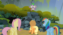 Spike jumping off a pile of rocks S3E9