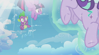 Twilight and Spike being sucked back into the time portal S5E25