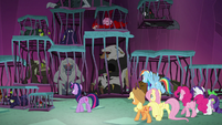 Ponies look at creatures in cages S8E26