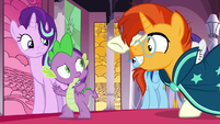 Sunburst extends a hoof-bump to Spike S7E25