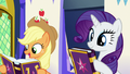 Applejack and Rarity with copies of the journal S7E14.png