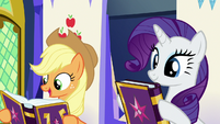 Applejack and Rarity with copies of the journal S7E14